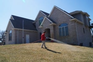 Exterior Services spraying lawn and yard